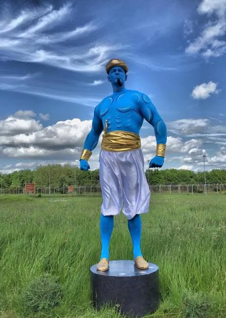 Blue Genie Statue by Electric Cabaret