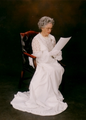Patricia Ford as Queen Elizabeth II